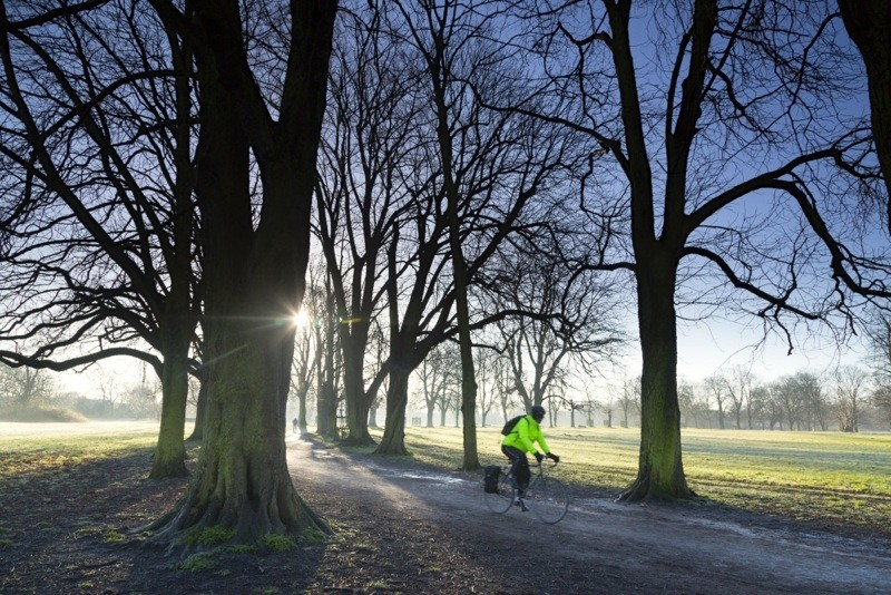 Cycling through Morden Hall Park, London, in the winter. Morden Hall Park is a serene oasis in the heart of suburban London