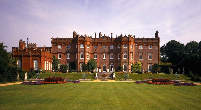 A view of the South Front of the Manor, also showing some bedding schemes. It was the home of Benjamin Disraeli from 1848 until his death in 1881. The garden recently restored to Victorian style