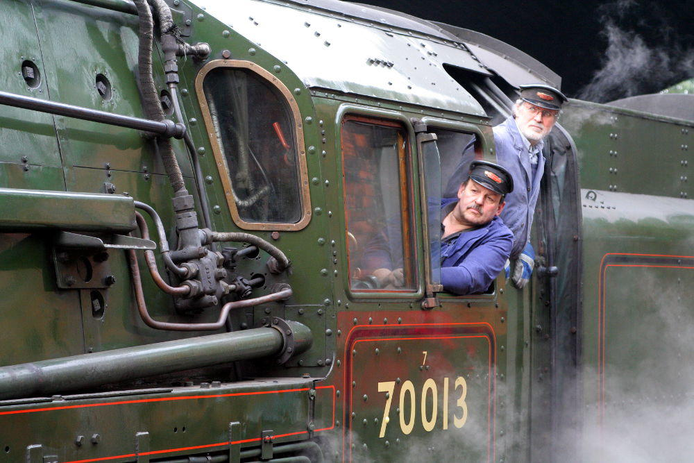 Steam railwaymen aboard'Oliver Cromwell' at Great Central Railway, Leicestershire