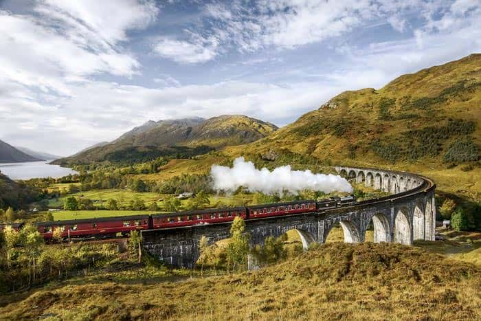 Jacobite steam train crossing the Glenfinnan Viaduct Scotland