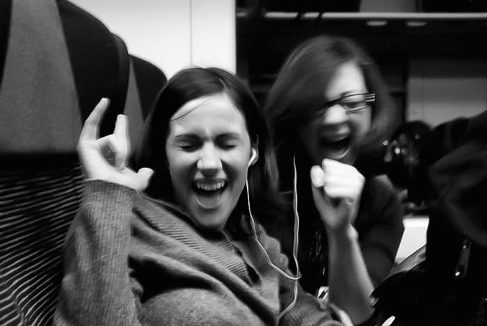 Two young ladies having fun on a train